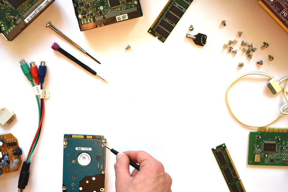 a tabletop of computer parts